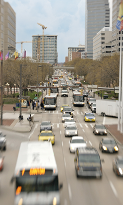 Buses Travelling Down Busy City Street