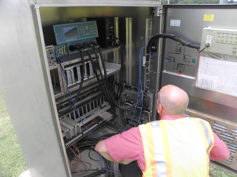 Photo of traffic cabinet being inspected